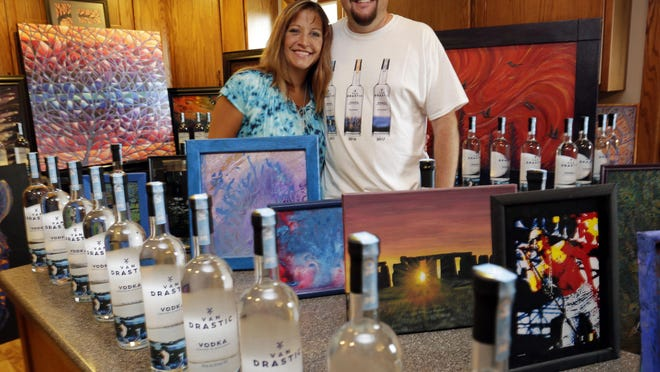 Sally and Grant Van Driest pose in their home with their Van Drastic Vodka and their artwork Tuesday Aug. 18, in Cedar Grove.