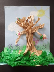 """""""Spring Tree"""" relief sculpture by Adley, a second-grade"""