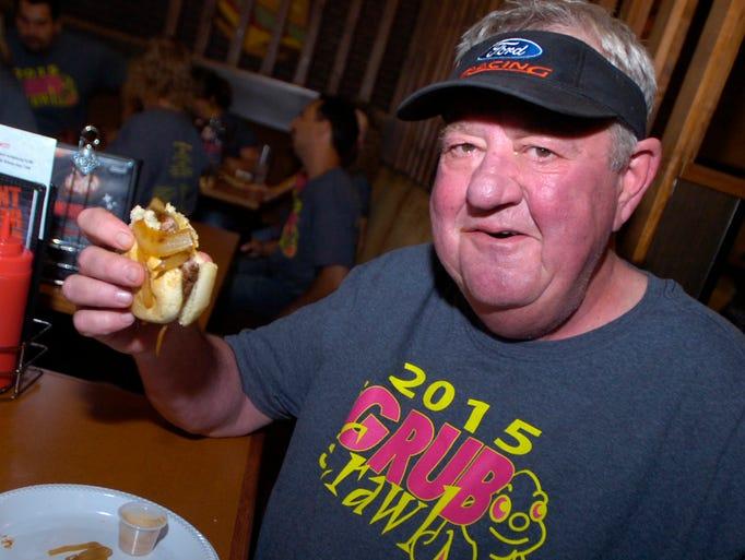 jim miller handles a tasty hamburger slider at the
