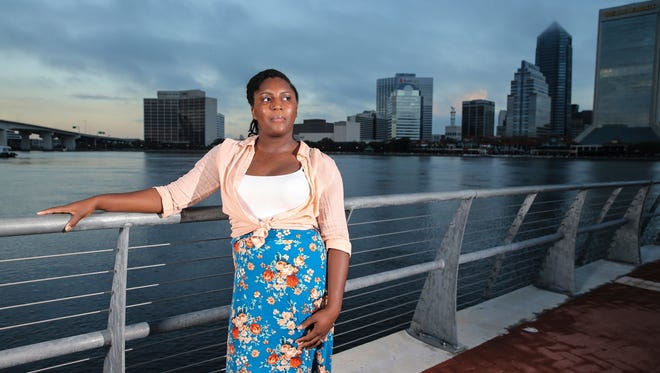Asia Howard poses for a photo at St. Johns River Park at sunrise, in Jacksonville, Fla. Howard was stuck in mostly retail and fast-food jobs after graduating high school, unable to get a job in banking, a profession she prized for its steady hours. After further developing her career and computer skills, she landed a job in mortgage lending that paid nearly double what she earned in previous jobs. Howard is now studying for an associate's degree in business administration at Florida State College at Jacksonville.