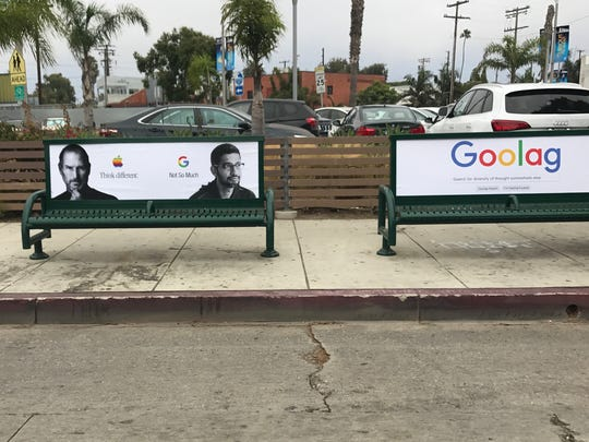 Side by side posters at a Venice Beach, California