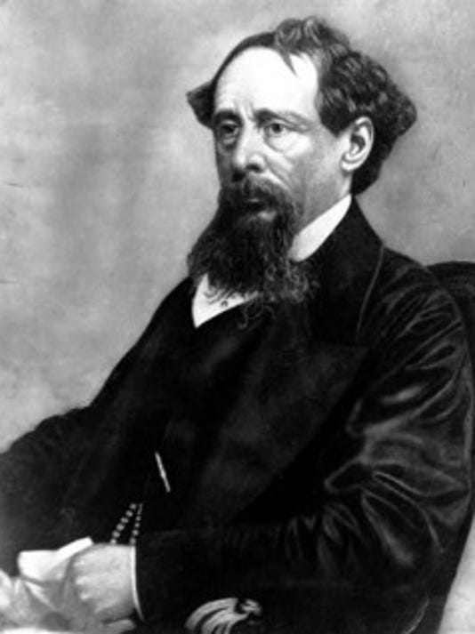 In this undated file photo, novelist Charles Dickens poses for a photograph. Britain's Prince Charles will laid a wreath Tuesday on the writer's grave in Westminster Abbey's Poet's Corner to mark his 200th of birthday. (ASSOCIATED PRESS)