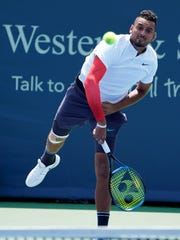 Nick Kyrgios makes a hit to Denis Kudla on the Grandstand