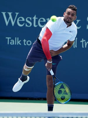 Nick Kyrgios makes a hit to Denis Kudla on the Grandstand during the Western and Southern Open at the Lindner Family Tennis Center in Mason Tuesday, August 14, 2018.