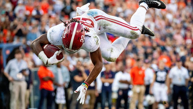 Alabama running back Najee Harris (22) dives in for a touchdown against Auburn during a Southeastern Conference game Nov. 30, 2019, at Jordan-Hare Stadium in Auburn, Ala.