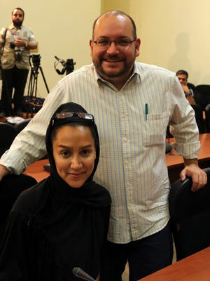 """Iranian-American Washington Post correspondent Jason Rezaian and his Iranian wife Yeganeh Salehi.  Rezaian was held on espionage and three other charges including """"collaboration with hostile governments."""""""