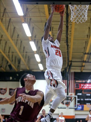 Anderson's DeAnthony McCallum dunks over Turpin guard A'Drien Baker.