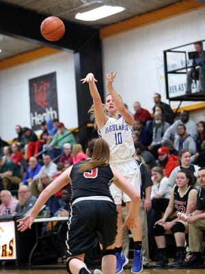 Highlands' Brianna Adler hits a 3-pointer as she's being defended by Newport's Star Yeager. The Bluebirds won the game, 81-58.