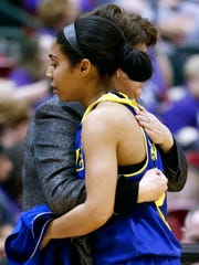 Delaware senior Courtni Green is hugged by head coach Tina Martin as she leaves the game late in the second half of the Hens' 68-47 loss in a CAA tournament semifinal at the Show Place Arena in Upper Marlboro, Md. Friday.