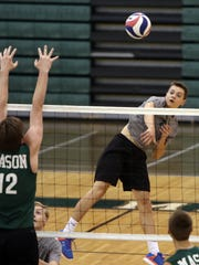 McNick's Grant Painter attempts a spike.