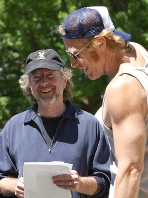 "Director Jay Craven, left, laughs with actor Rusty DeWees during the first day of shooting in West Barnet, Vt., for Craven's ""Windy Acres"" television show in 2004."