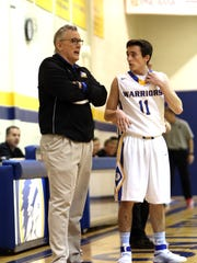 Mariemont Head Coach Jim Leon instructs Andrew Hall