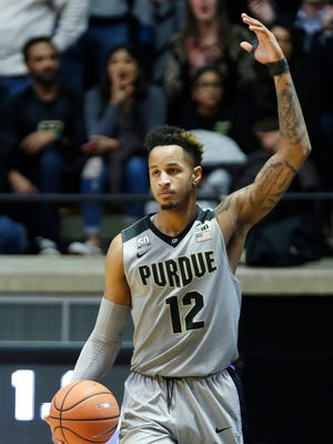 Vincent Edwards of Purdue waves to the crowd as he heads to the line to shoot free throws against Michigan Thursday, January 25, 2018, at Mackey Arena. Purdue defeated Michigan 92-88.