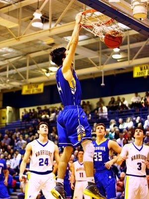 Madeira guard Kyle Johnson dunks in the boys basketball game between the Madeira Mustangs and the Mariemont Warriors at Mariemont High School, Jan 26, 2018.