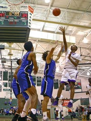 Aiken guard Tremaine Smith attempts a running shot in the Boys Division II Sectional Tournament at Mason High School February 24, 2018.