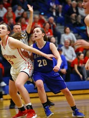Walton-Verona guard Emma Strunk battles for position