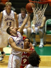 In this 2007 file photo, Muncie Central's Ben Botts goes for a layup during the second half of the boys Indiana All Star game at the New Castle High School Fieldhouse.