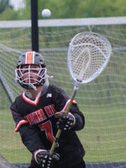 Brother Rice's senior goalie Jack Michael (7) makes