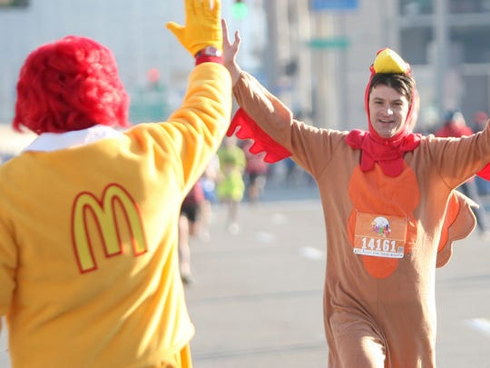 Bihl, of Hyde Park, gives a high five to Ronald McDonald