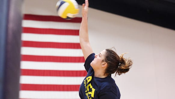 Raegan Waites spikes the ball during practice at Asheville