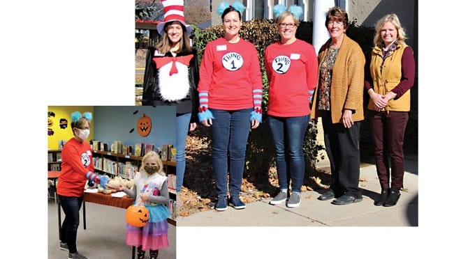 (Top) The Dyckman Free Library staff stepped outside for a picture on Friday afternoon, Oct. 30, when the library hosted a walk-through Halloween Trick-or-Treat event, from left: Library Aide Katie Roiger, Library Director Lisa Steffl, and Library Aides Angela Mielke,  Patti Braulick, and Sarah Hinderman.  (left) Kids were invited to come to the library Friday afternoon to pick up a treat bag and mini-pumpkin. Pictured are Angela Mielke and Olivia Hinderman.