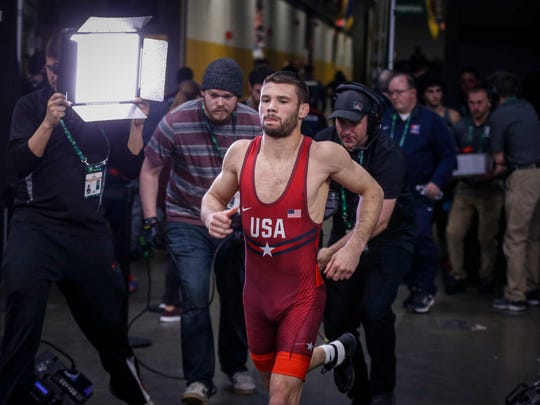 Team USA's Thomas Gilman makes his way to the mat for his match against Georgia's Teimuraz Vanishvili at 57 kg during the freestyle wrestling World Cup in Iowa City on Sunday, April 8, 2018.