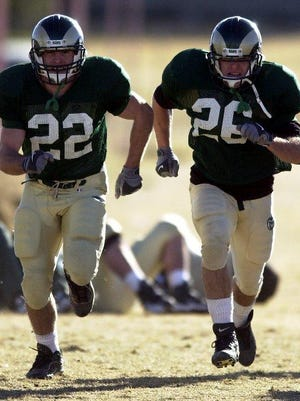 Colorado State football players Jason, left, and Justin Gallimore run sprints at practice in this 2000 file photo.