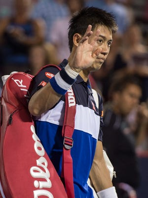 Kei Nishikori of Japan walks off the court following his loss to Andy Murray of Great Britain during the semifinals at the Rogers Cup tennis tournament Saturday Aug. 15, 2015 in Montreal.