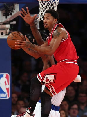 Derrick Rose had 13 points in the Bulls' season-opening rout of the Knicks.