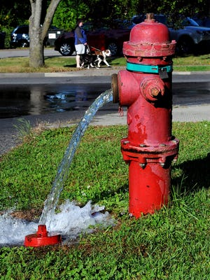 The City of Poughkeepsie flushed water from select hydrants as part of its response to a bacterial contamination that forced city residents to boil water for five days in July 2013. In this 2013 file photo, water pours from a hydrant at the intersection of North Hamilton Street and Mansion Street.