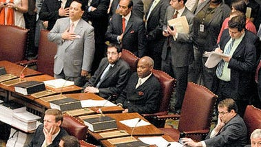 This June 23, 2009, photo of New York State Senate Democrats remaining seated while Republicans say the Pledge of Allegiance has recently gone viral on Facebook. The photo was taken during a chaotic Senate coup, with Democrats refusing to recognize the GOP-led session.