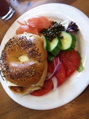 Luxe lox: A Café Patachou bagel with naturally-smoked salmon, tomatoes, cucumbers, cream cheese and a side of capers, red onions and imported olives.