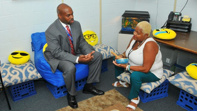 Superintendent Desmond Blackburn talks with Jackie Small, a guidance counselor at Saturn Elementary in Cocoa, about the room she set up for students to calm themselves down.