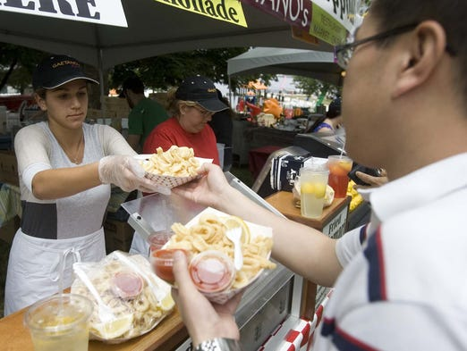 Juliette LaFerlita of Middletown  hands Jin Zhang of Edison two orders of calamari.
