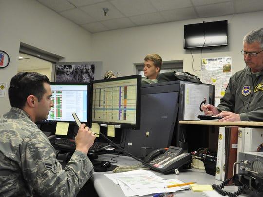 A1C Matthew Rivera, seated, gives flight instructions