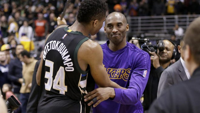 Kobe Bryant of the Lakers hugs Giannis Antetokounmpo after Bryant's final game in Milwaukee on Monday night. Antetokounmpo finished with a triple-double.