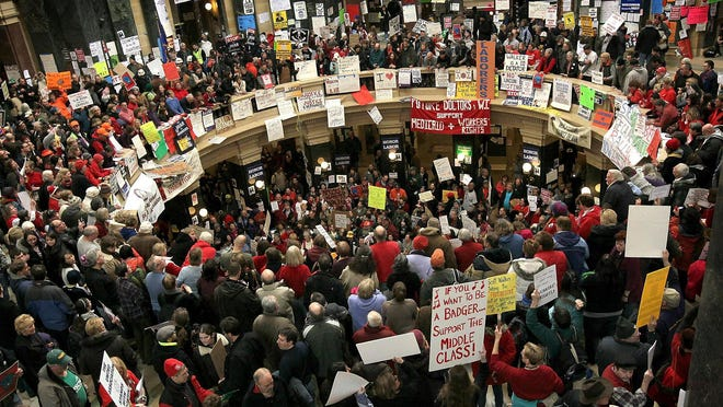 Protestors demonstrate in the Capitol rotunda in Madison on Feb. 25, 2011.
