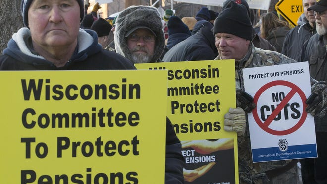 Teamsters from Wisconsin and Michigan demonstrate against proposed cuts in the Central States Pension Fund before the PBS Newshour Democratic Debate in February.
