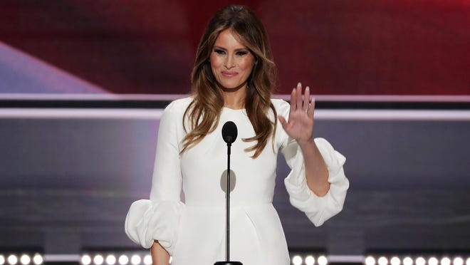 Melania Trump, wife of presumptive Republican presidential nominee Donald Trump, waves to the crowd after delivering a speech on the first day of the Republican National Convention on Monday at the Quicken Loans Arena in Cleveland, Ohio.