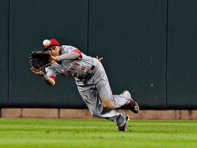 Cincinnati Reds center fielder Billy Hamilton (6) dives and catches a line drive hit by St. Louis Cardinals first baseman Matt Adams (not pictured) during the sixth inning at Busch Stadium.