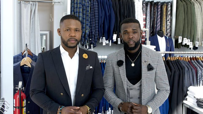 Frantz Junior Chérilus, founder of Rich Men Looks mobile boutique, and his brother, Peter J Cherilus, sit inside the new Boynton Beach storefront location.