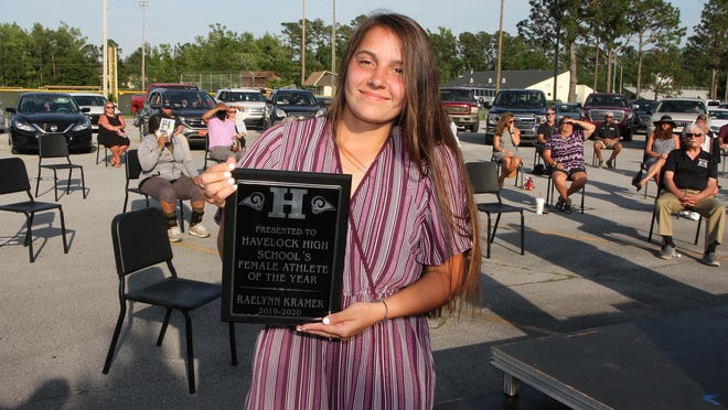Raelynn Kramer receives the Female Athlete of the Year Award at the Havelock High School Senior Athletic Banquet held at Havelock High School in Havelock, NC, June 2, 2020. Awards are presented by Principal Stacie Friebel, Tameka Wiggins, athletic director, and Brent Wooten, assistant football coach. The safety first event facilitated a drive-up audience of parents, friends and staff to recognize student athletes who received awards, plaques and gift cards. The  annual Senior Athletic Banquet is sponsored by the Havelock Rams Booster Club.