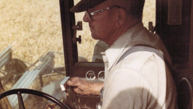 Monte Moser's father, Albert, driving a combine in South Dakota. He and his sons had a custom-cutting business for many years and followed the wheat harvest from South Dakota to Oklahoma.