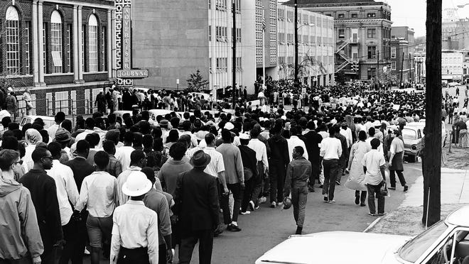 Voting rights protesters march past the offices of the Advertiser and Journal in Montgomery Ala. on March 17, 1965.