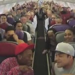 """The cast of """"The Lion King"""" sings """"The Circle of Life"""" on the way to Sydney."""