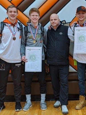 Newcomerstown High School head coach Jericoe Jones poses with his squad's state wrestlers Coltin Meek, Gavin Weaver and Logan Hursey this past season. Provided photo