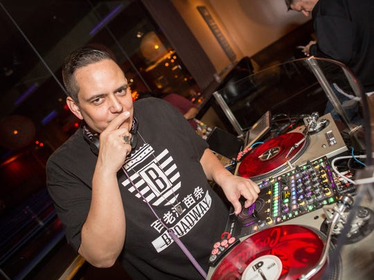 DJ Pickster One ponders his beats at Lucky Strike's Motown Bowling Bash on Wednesday, November 26, 2015.