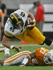 Former Iowa Hawkeyes running back Mark Weisman, top, has bulked up to play fullback in the NFL.