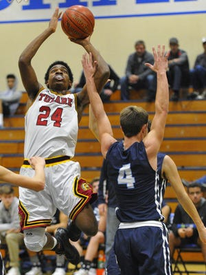 Tulare Union's Jayden Cain rise for a shot against Central Valley Christian during Tuesday's first-round game of the 66th annual Polly Wilhelmsen Invitational at Redwood High School.