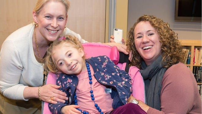 Sen. Kirsten Gillibrand, D-N.Y., left, meets with 4-year-old Morgan Jones of North Salem, and her mother Kate Hintz, at the Drug Policy Alliance office in New York in February to discuss legislation that would allow states to set their own medical marijuana policies.